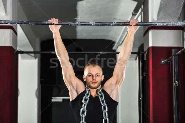 Homem horizontal bar atleta metal Foto stock © AndreyPopov