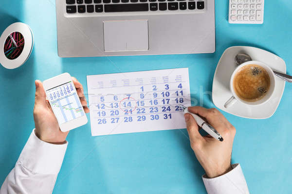 Businessman Marking Schedule On Calendar Using Gantt Chart Stock photo © AndreyPopov