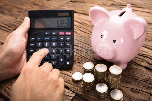 Stock fotó: üzletember · számológép · érmék · persely · asztal · kép