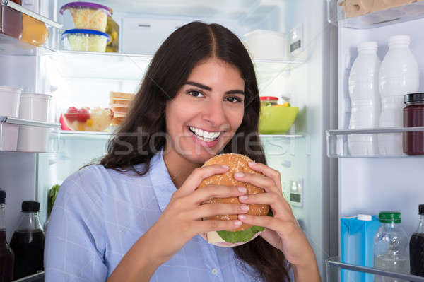 Happy Woman Holding Fresh Burger Stock photo © AndreyPopov
