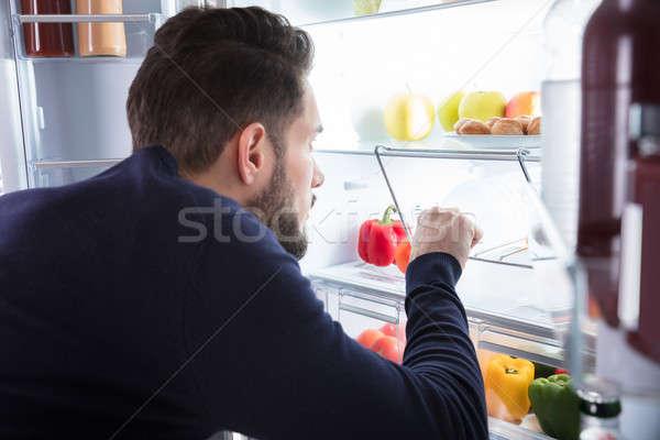Adam buzdolabı genç ev Stok fotoğraf © AndreyPopov