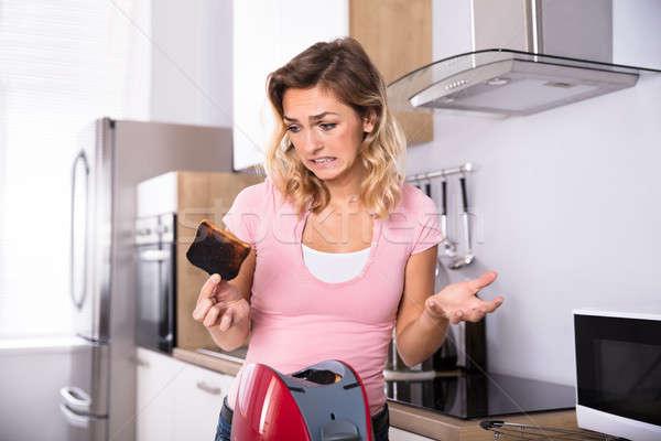 женщину Ломтики тоста молодые несчастный тостер Сток-фото © AndreyPopov
