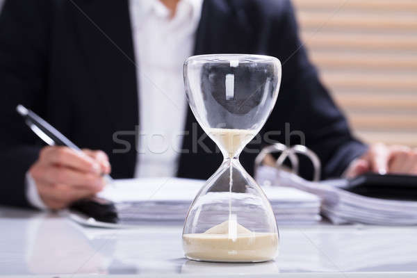 Hourglass With Businesswoman Calculating Bill Stock photo © AndreyPopov