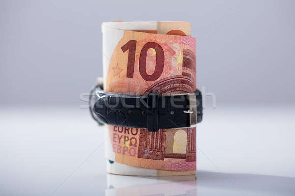 Rolled Up Ten Euro Banknotes Tied With Belt Stock photo © AndreyPopov