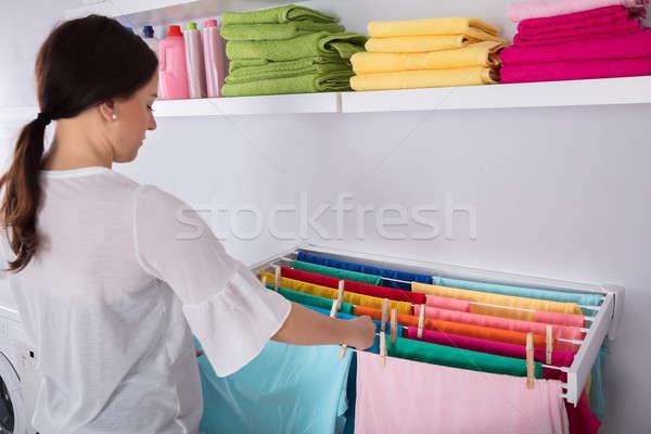 Kadın asılı ıslak elbise çamaşırhane oda Stok fotoğraf © AndreyPopov