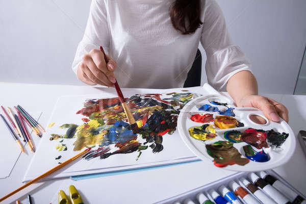 Művész tart festék paletta festmény vászon Stock fotó © AndreyPopov