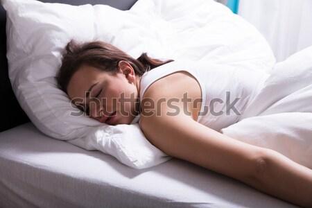 Donna dormire letto primo piano faccia Foto d'archivio © AndreyPopov