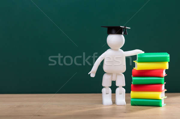 Human Figure Standing Beside Stacked Books Stock photo © AndreyPopov