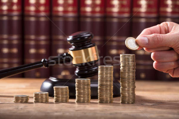 Közelkép emberi kéz érme egymásra pakolva érmék pénz Stock fotó © AndreyPopov