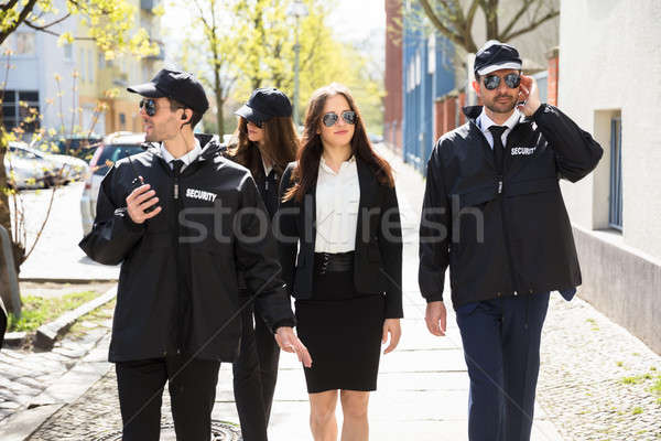 Portrait Of Female Celebrity With Bodyguards Stock photo © AndreyPopov