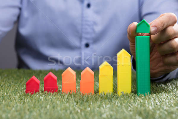 Person Placing House Model Over Green Bar Stock photo © AndreyPopov