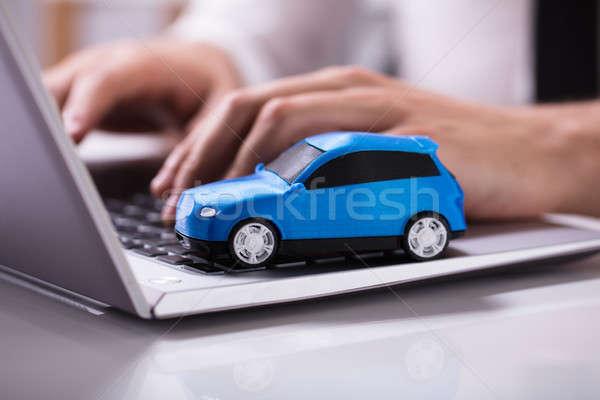 Blue Car On Laptop Keypad Stock photo © AndreyPopov