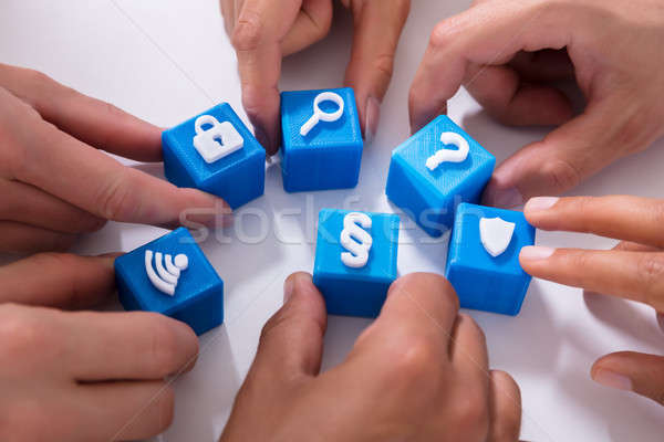 Businesspeople Holding Cubic Blocks With Various Icons Stock photo © AndreyPopov