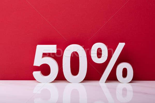 Branco cinqüenta por cento venda assinar vermelho Foto stock © AndreyPopov