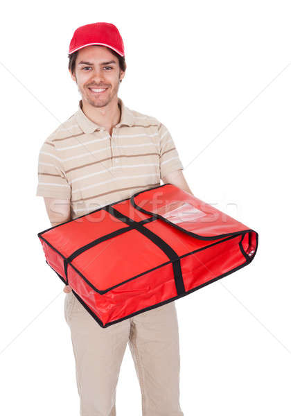 Pizza delivery boy with thermal bag Stock photo © AndreyPopov