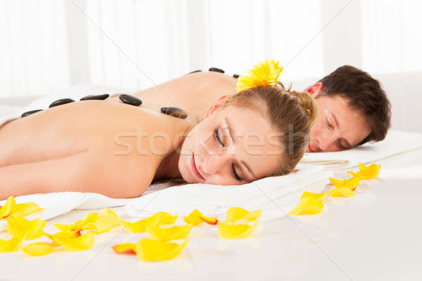 çift sıcak taş masaj tedavi spa Stok fotoğraf © AndreyPopov