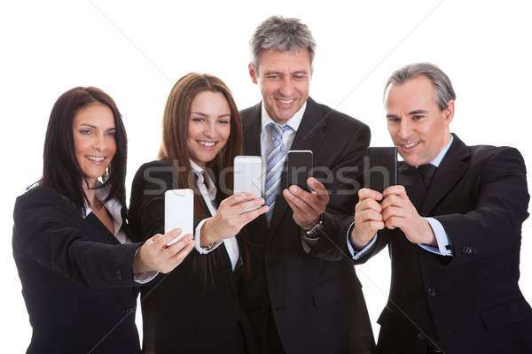 Business People Looking At Cell Phones Stock photo © AndreyPopov