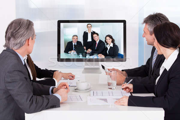 Group Of Businesspeople In Video Conference Stock photo © AndreyPopov