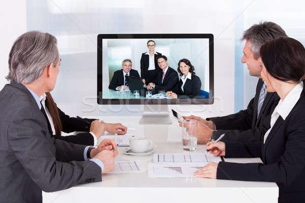 Groep video conferentie zakelijke bijeenkomst business Stockfoto © AndreyPopov