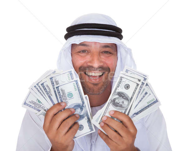 Portrait Of Mature Arab Man Holding Dollars Stock photo © AndreyPopov