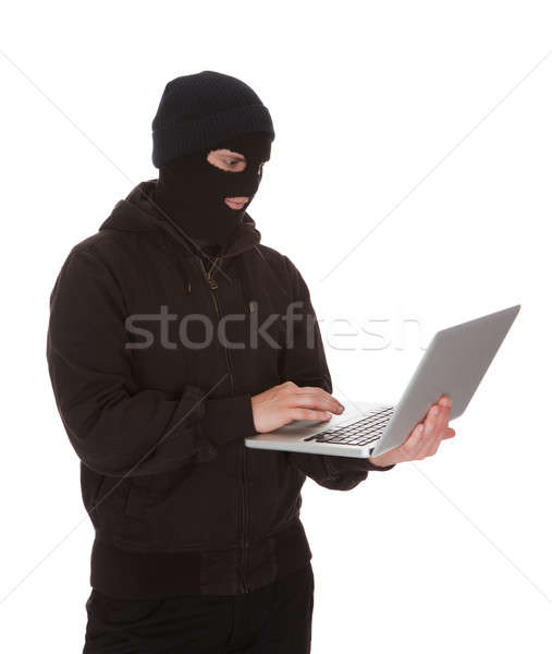 Burglar Holding Laptop Stock photo © AndreyPopov