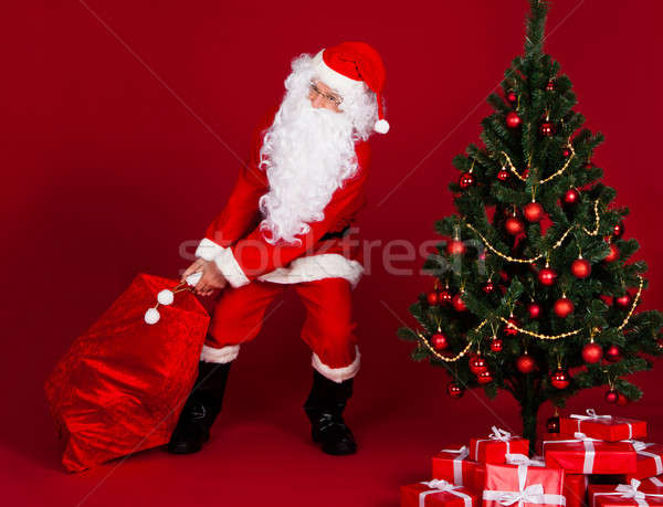 Santa pulling gifts sack Stock photo © AndreyPopov