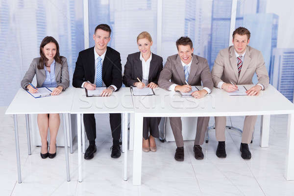 Corporate Personnel Officers Sitting At Table Stock photo © AndreyPopov