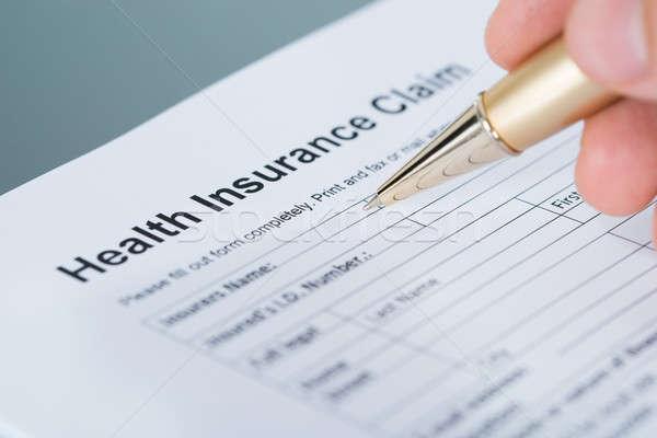 Ubezpieczenie zdrowotne dochodzić formularza strony nadzienie Zdjęcia stock © AndreyPopov