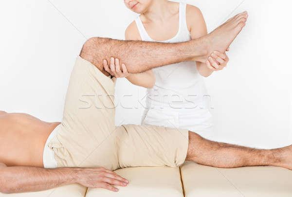 женщину ногу молодым человеком таблице массаж Сток-фото © AndreyPopov