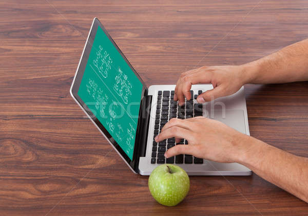 Student Solving Math's Problem On Laptop Stock photo © AndreyPopov