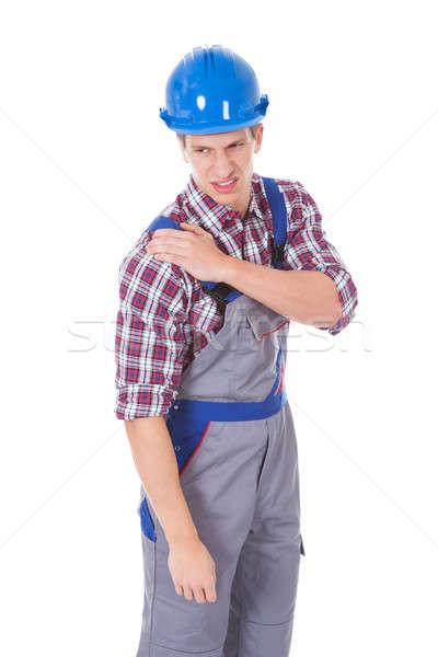 Werknemer schouderpijn portret geïsoleerd witte bouw Stockfoto © AndreyPopov