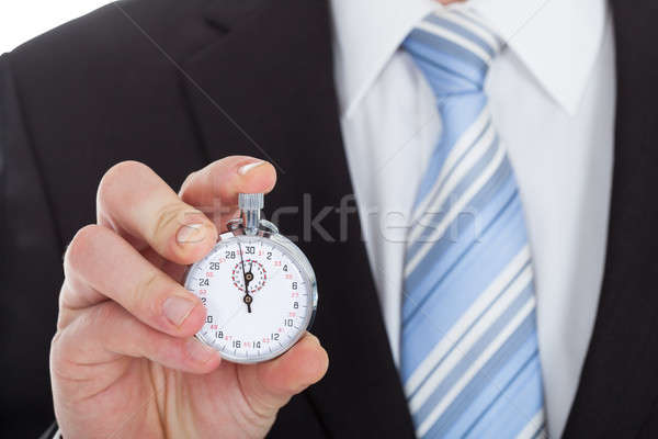 Midsection Of Businessman Showing Stopwatch Stock photo © AndreyPopov