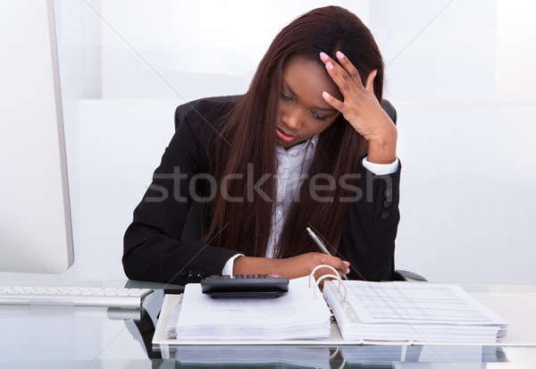 Tensed young businesswoman Stock photo © AndreyPopov