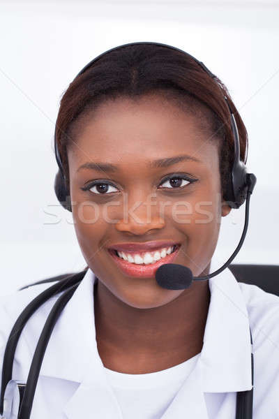 Confident Receptionist Using Headset In Hospital Stock photo © AndreyPopov
