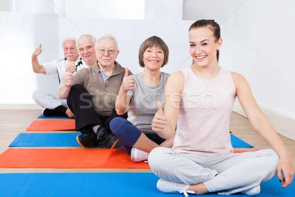Trener starszy klientela siłowni portret posiedzenia Zdjęcia stock © AndreyPopov