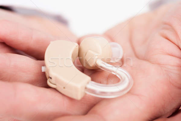 Person Holding Hearing Aid Stock photo © AndreyPopov