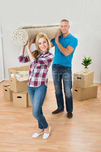 Couple Carrying Rolled Carpet Stock photo © AndreyPopov