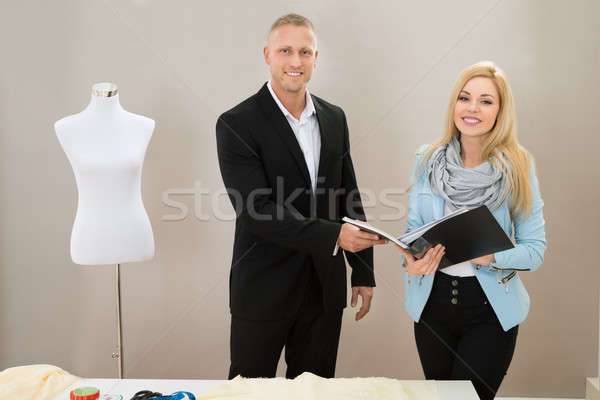 Stock photo: Female Tailor With Client In Store