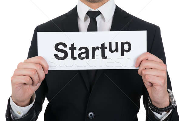 Businessman Holding Startup Sign Stock photo © AndreyPopov
