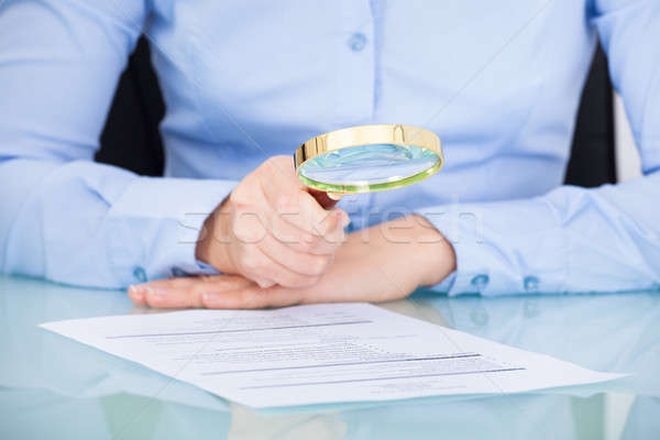 Businesswoman Holding Magnifying Glass Stock photo © AndreyPopov