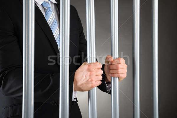 бизнесмен тюрьму металл баров Сток-фото © AndreyPopov