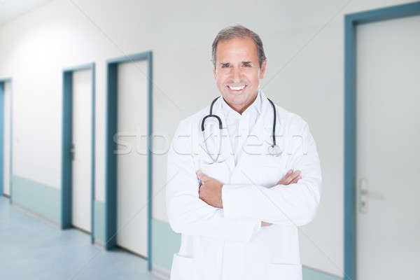 Senior Doctor With Arms Crossed Standing In Hospital Stock photo © AndreyPopov