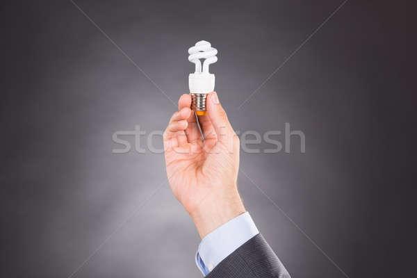 ストックフォト: ビジネスマン · 手 · 電球 · 暗い · 男
