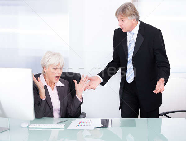 Two Businesspeople Arguing With Each Other Stock photo © AndreyPopov