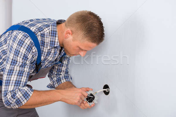 Stock photo: Electrician Installing Electrical Socket