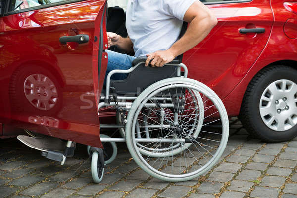 Disabled Man Boarding In His Car Stock photo © AndreyPopov