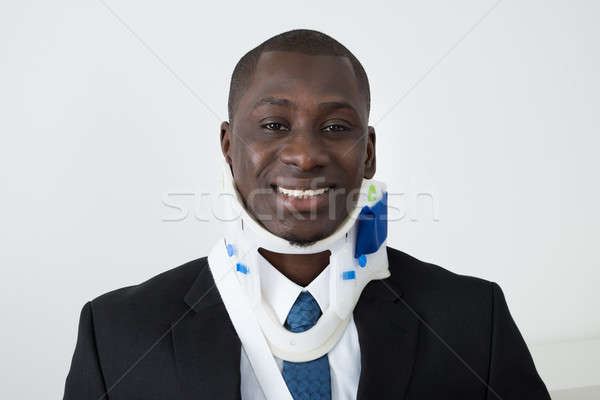 African Businessman With Neck Brace Stock photo © AndreyPopov