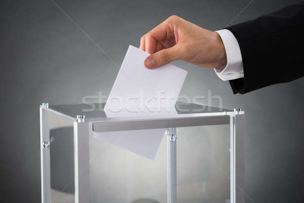 Businessperson Putting Ballot In Box Stock photo © AndreyPopov