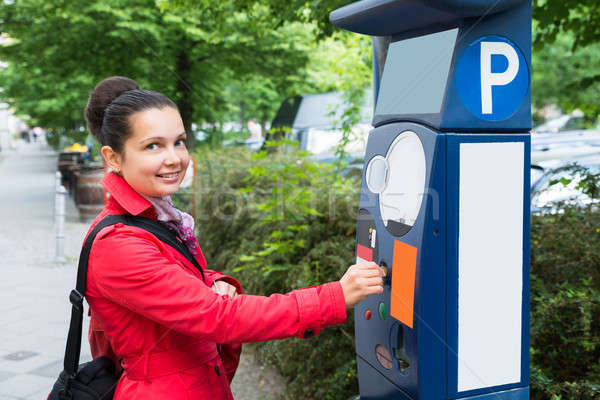Woman Inserting Coin In Parking Meter Stock photo © AndreyPopov