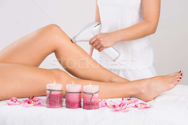 Young Woman Getting Laser Treatment On Leg At Spa Stock photo © AndreyPopov